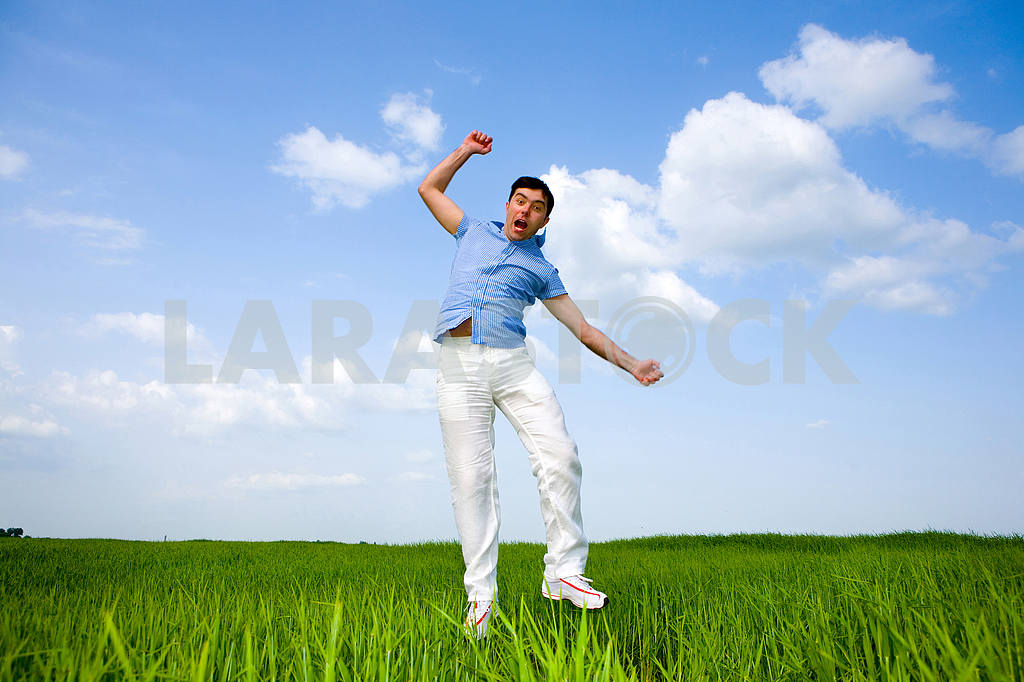Happy man is jumping in a field — Image 10014