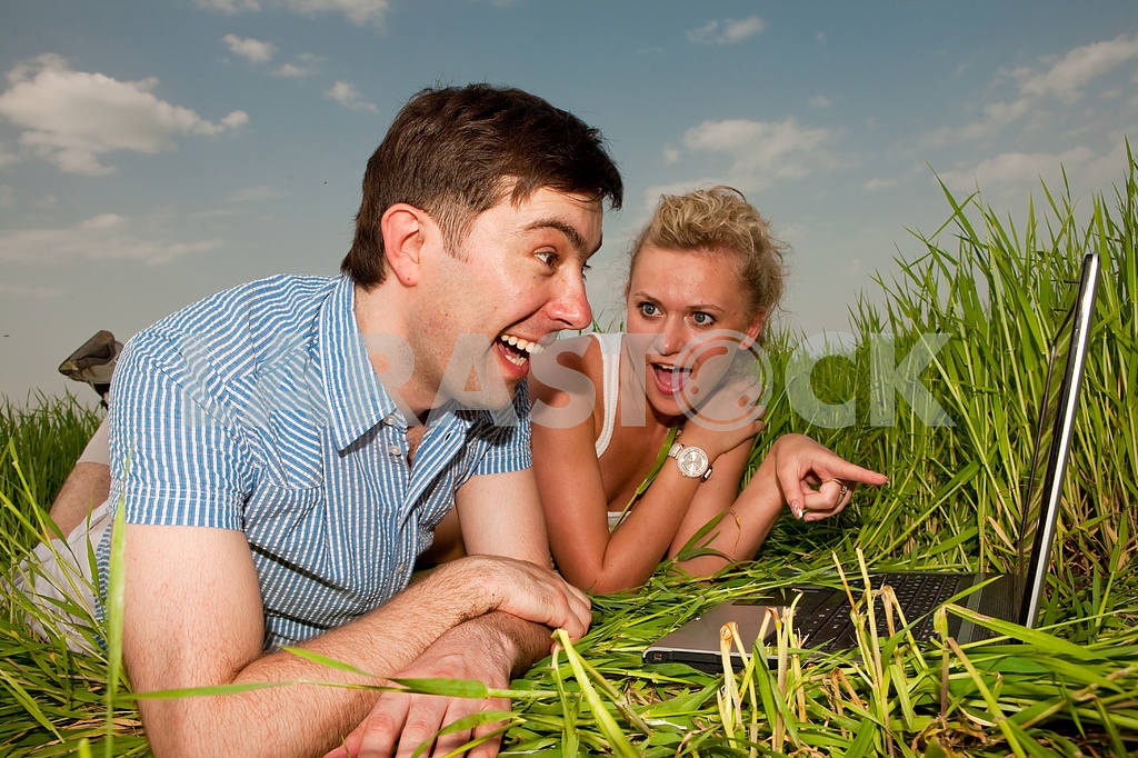 Casual happy couple are talking  and laughing on a laptop comput — Image 10071
