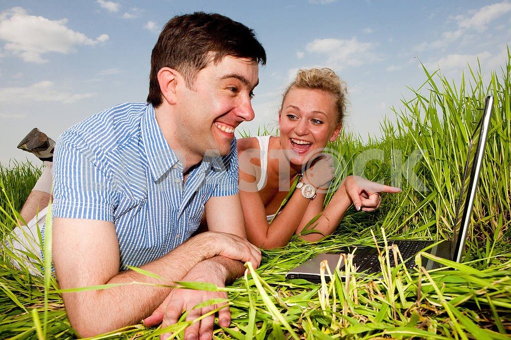 Casual happy couple are talking  and laughing on a laptop comput — Image 10072