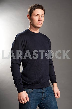 Young men dressed in sweater and jeans