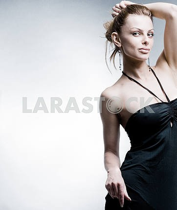 Beautiful Young woman in black dress.  In studio.