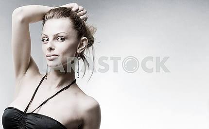 Beautiful Young woman in black dress.  In studio.