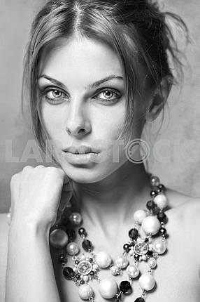 Portrait young woman with beads