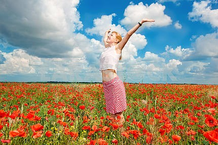 Girl in a field of poppies