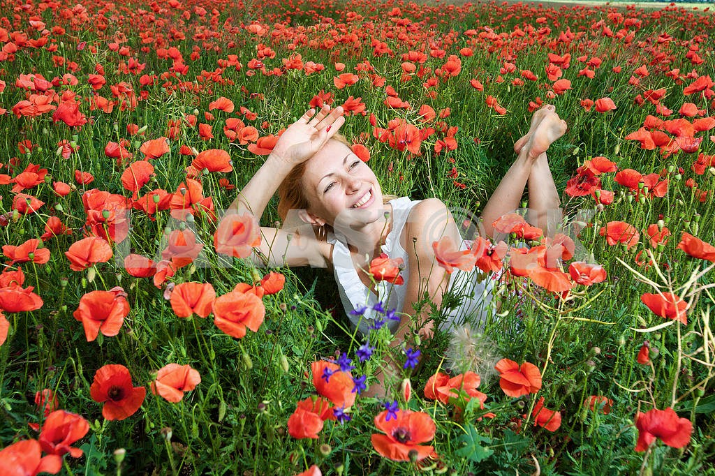 Girl in a field of poppies — Image 10639
