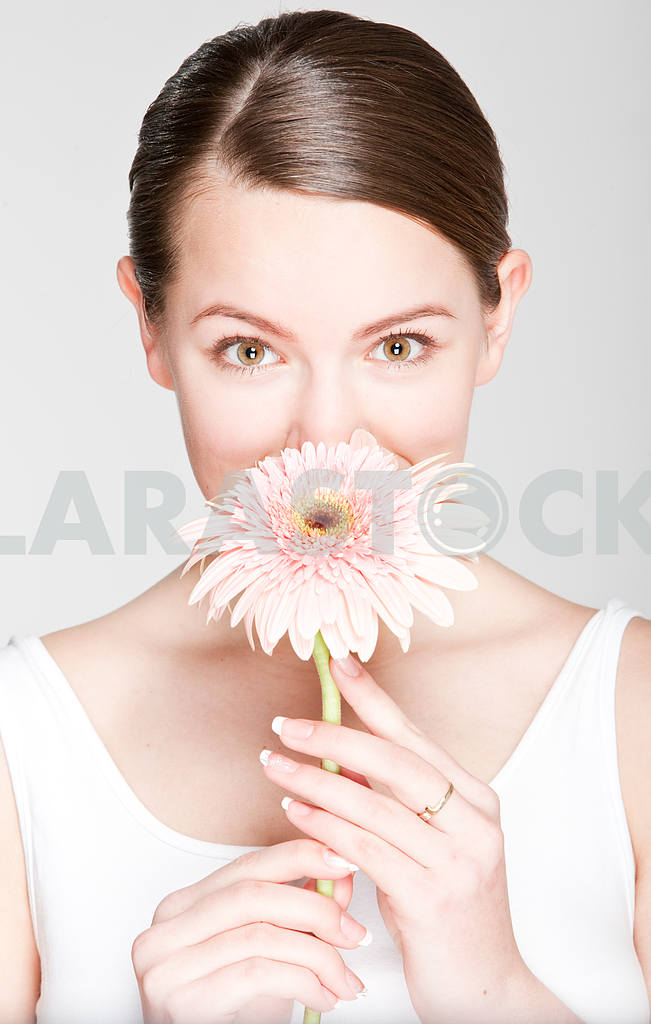Portrait Beautiful girl with flower. Focus on eyes — Image 10874