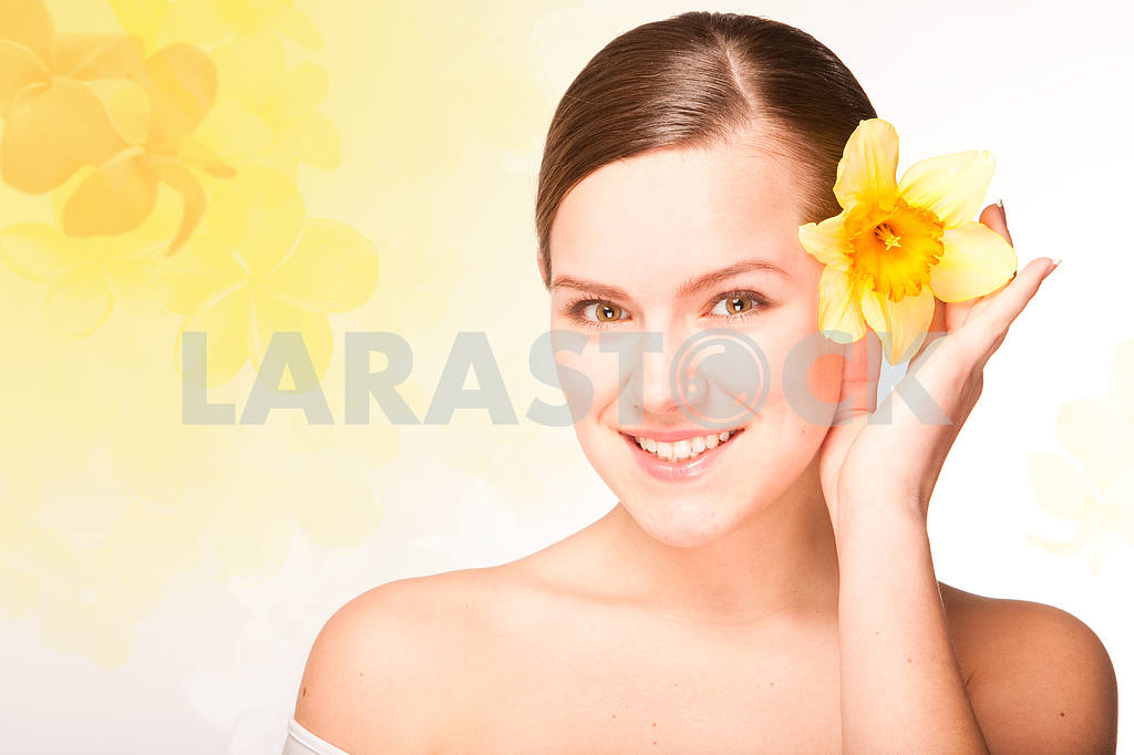 Portrait Beautiful girl with flower. Focus on eyes — Image 10902
