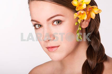 Portrait Beautiful girl with flower. Focus on eyes