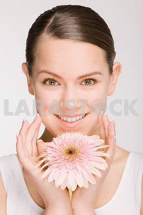 Portrait of Fresh and Beautiful girl with flower