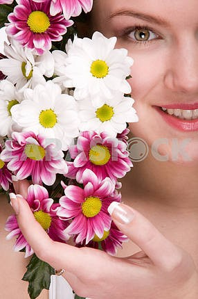 Attractive girl face with flowers