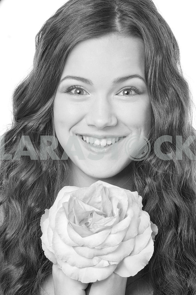 Portrait Beautiful girl with flower. Focus on eyes — Image 10965