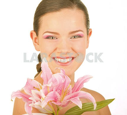 Beautiful young girl with flower. Focus on eyes