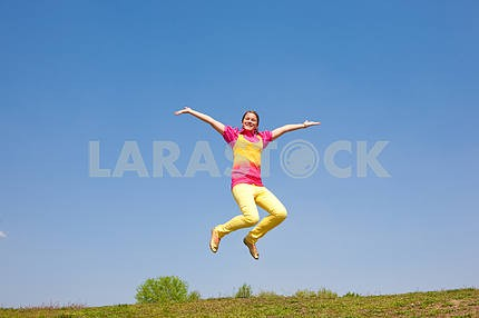 Happy smiling girl - jumping