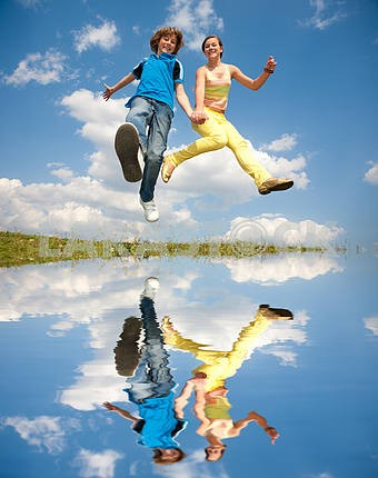 Girl and boy jumping. Soft focus. Focus on eyes.