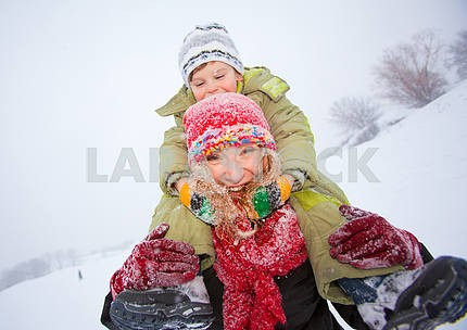 Portrait happy mother and child together in snow  laughing, smil