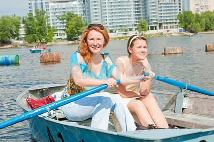 Mom and Daughter relax in boat