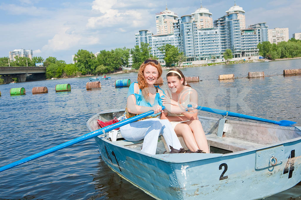 Mom and Daughter relax in boat  — Image 11516