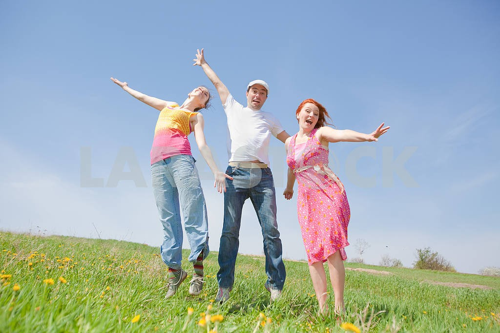 Happy people is jumping in field — Image 11562