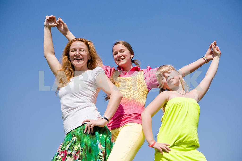 Happy Mother and two daughter jumping — Image 11587