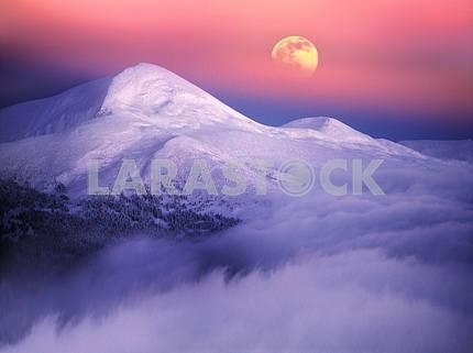 Moonrise among alpine peaks