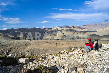 Man on a background of mountains