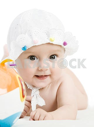 Smiling child with a toy