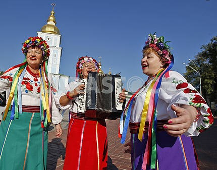 Women dressed in Ukrainian clothes.