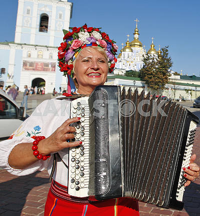 Woman dressed in Ukrainian clothes.