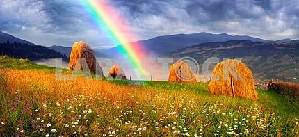 Rainbow over haystacks