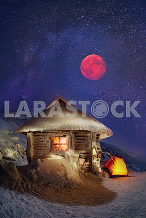 Tents and shelter under a full moon