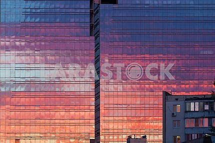 Kiev, sunset reflected in the windows of a building under construction
