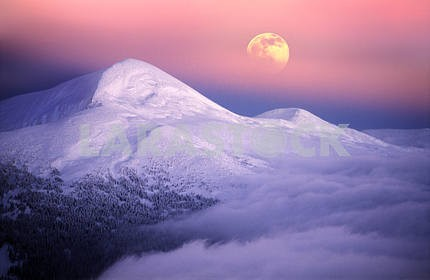 Moonrise among alpine peaks