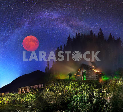 The Milky Way and the moon over the mountains