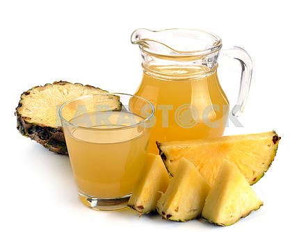 Full glass and jug of pineapple juice