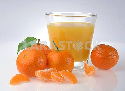 Tangerine and juice glass