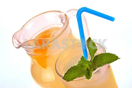 Lemon juice in a jug and a glass with mint