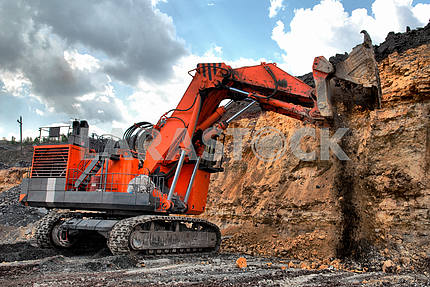 Big dredge digs the earth