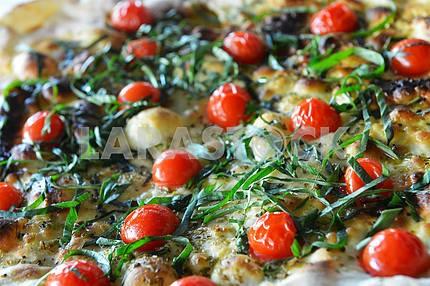Pizza mozzarella with cherry tomatoes