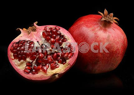 Pomegranate whole and open-face with seeds