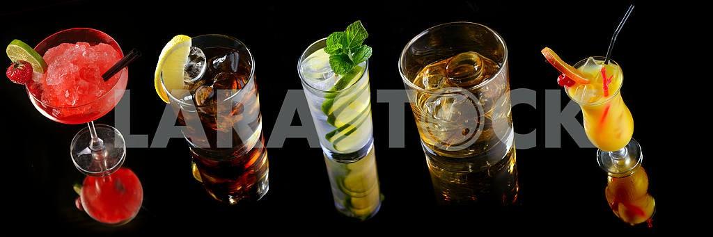 Set cocktails on black background
