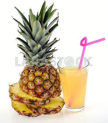 glass of fresh pineapple juice and fruit