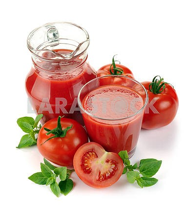 Jug, glass of tomato juice and fruit