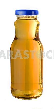 Grape juice in a little glass bottle
