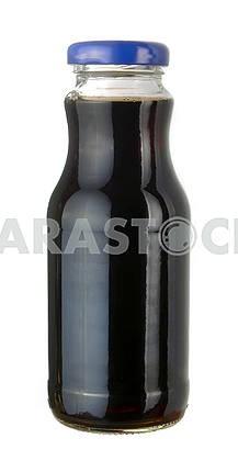 Pomegranate juice in a little glass bottle