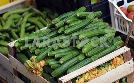 Zucchini in a wooden box