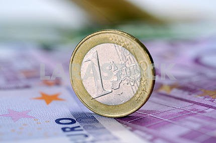 one euro coin on a banknote 500 euros
