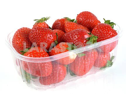 Ripe strawberries in a plastic container