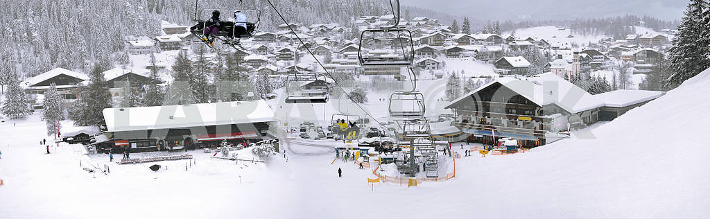 Ski lift and slopes in high mountains