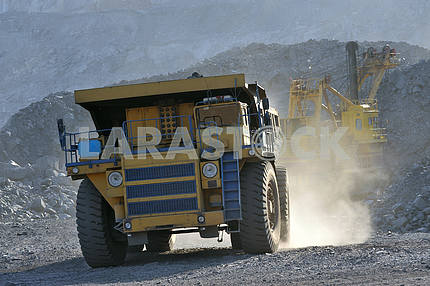 Large truck traveling in the dust