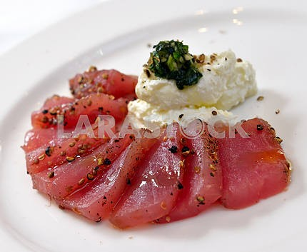 Tuna carpaccio with cheese garlic and basil